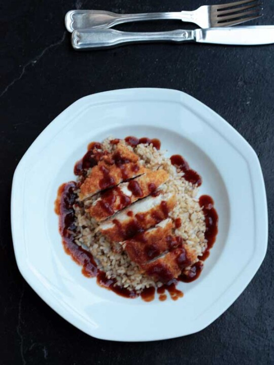 Easy crispy chicken katsu on a white plate from above