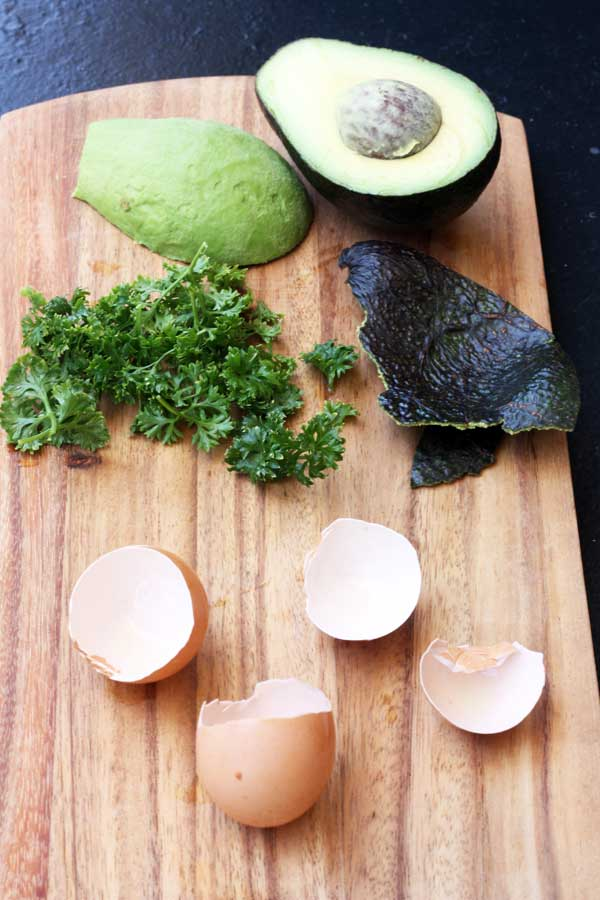 Ingredients for a breakfast of poached eggs with avocado, spinach & crispy quinoa