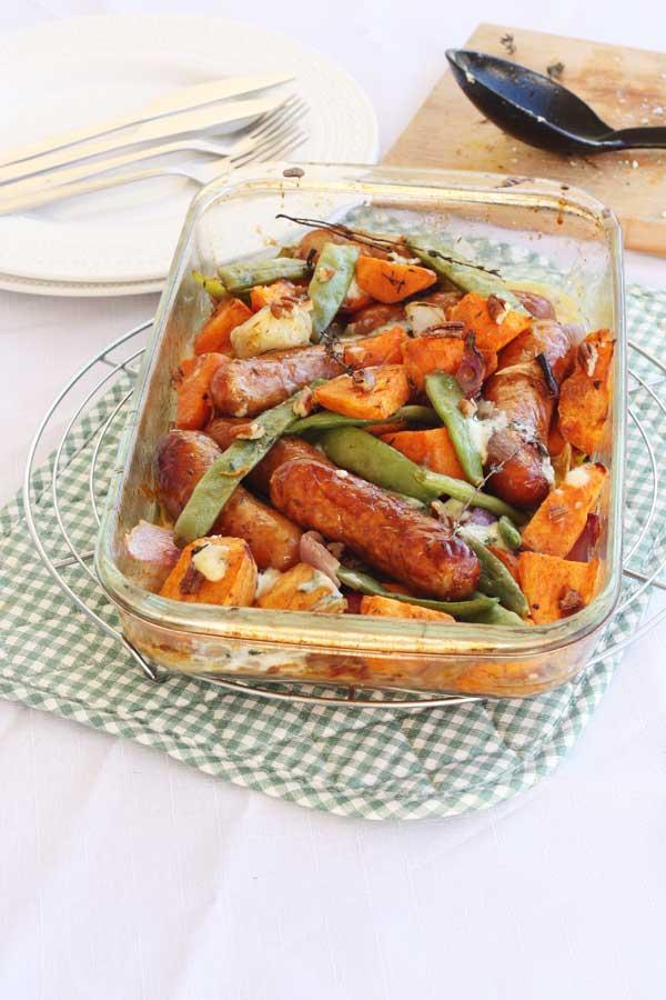 Sausage, sweet potato & orange tray-bake from Scrummy Lane