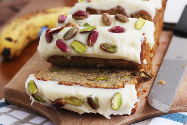 Slices of banana pistachio cake sliced off the rest of the cake