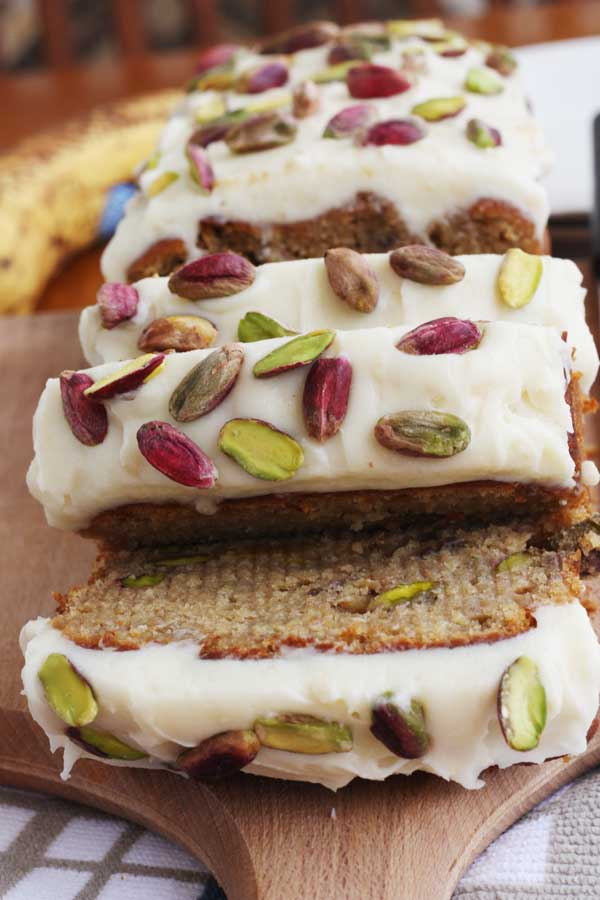banana & pistachio loaf with white chocolate cream cheese frosting