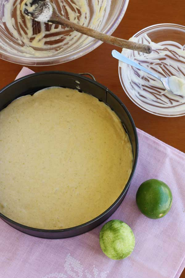 Making white chocolate, coconut & lime truffle cake