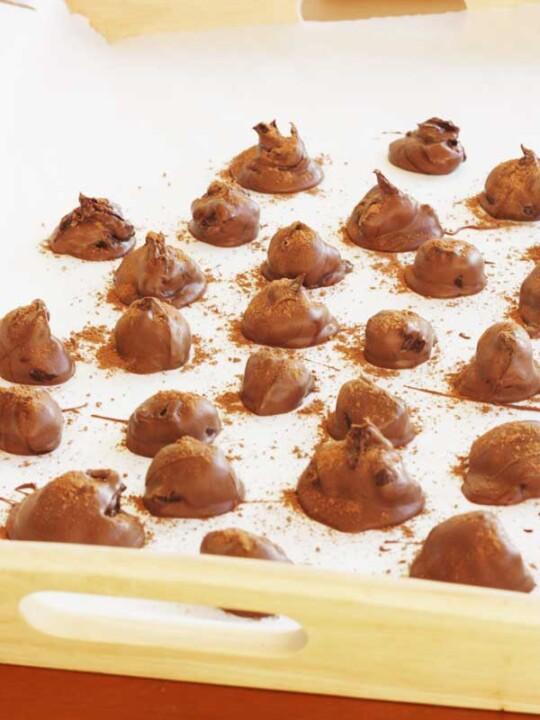 Chocolate orange truffles on a white tray
