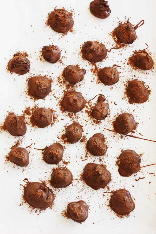 Chocolate orange truffles from above on a white background