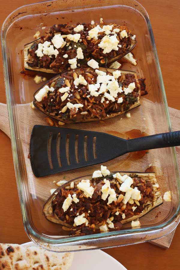 Greek stuffed 'little shoes' - aubergines stuffed with mince meat & topped with feta cheese - by Scrummy Lane