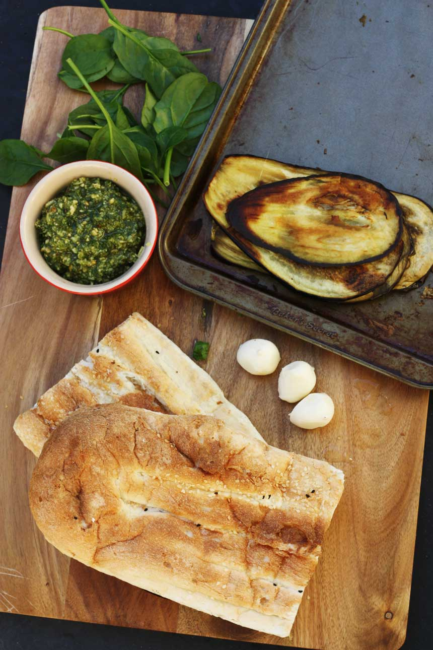 Making a roasted eggplant and pesto panini