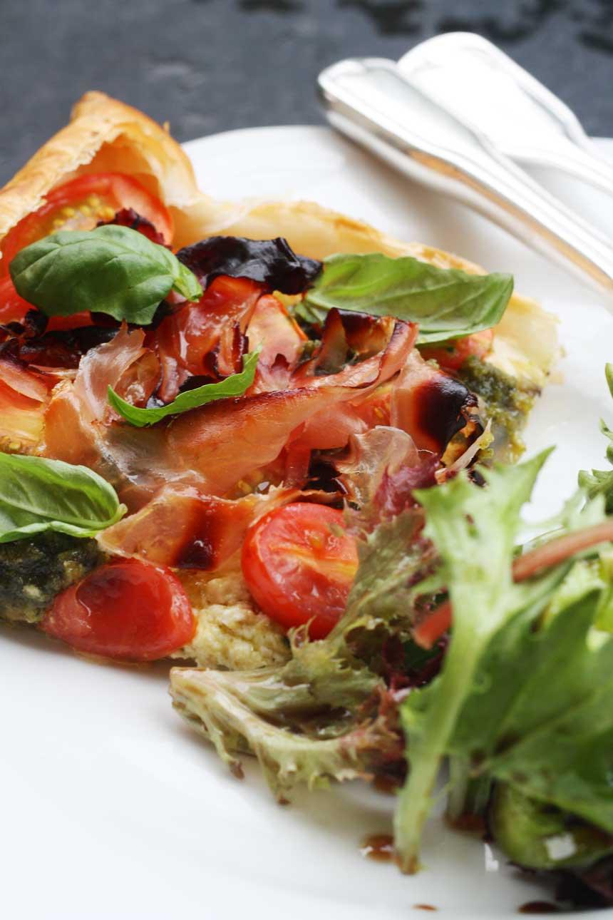 Baby tomato, pesto & prosciutto tart