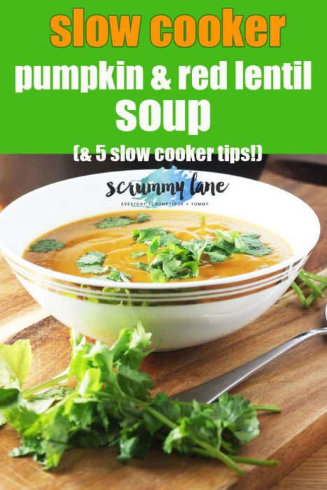 A bowl of pumpkin and red lentil soup sprinkled with fresh coriander