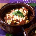 A brown dish of Greek baked eggplant with tomato sauce and feta