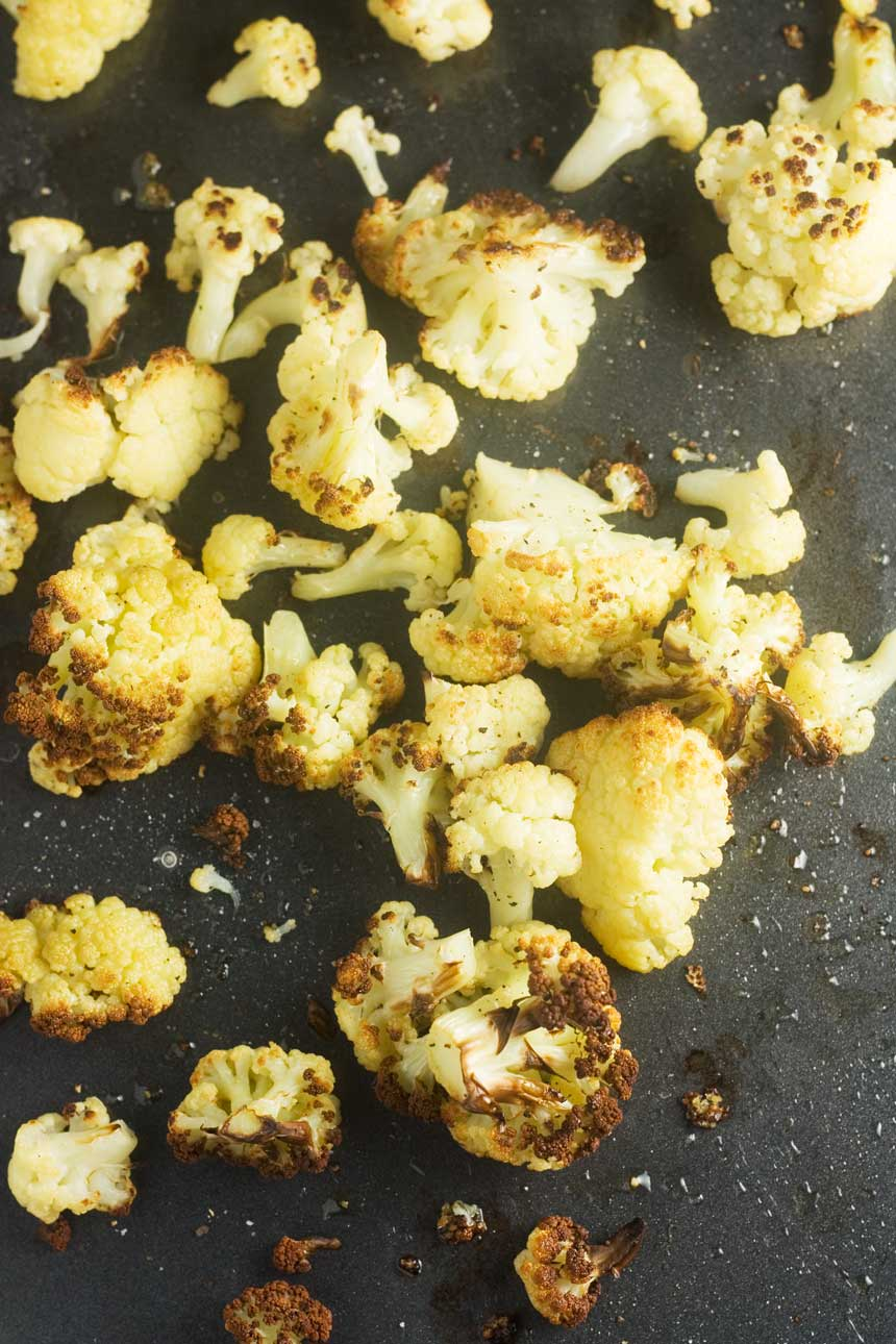 Roasted cauliflower on a baking tray from above