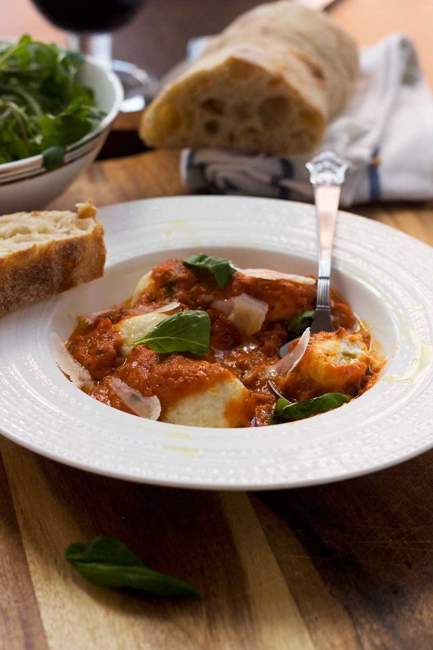 Easy ricotta gnudi with roasted tomato sauce. Gnudi are a bit like gnocchi but much lighter & easier to make!