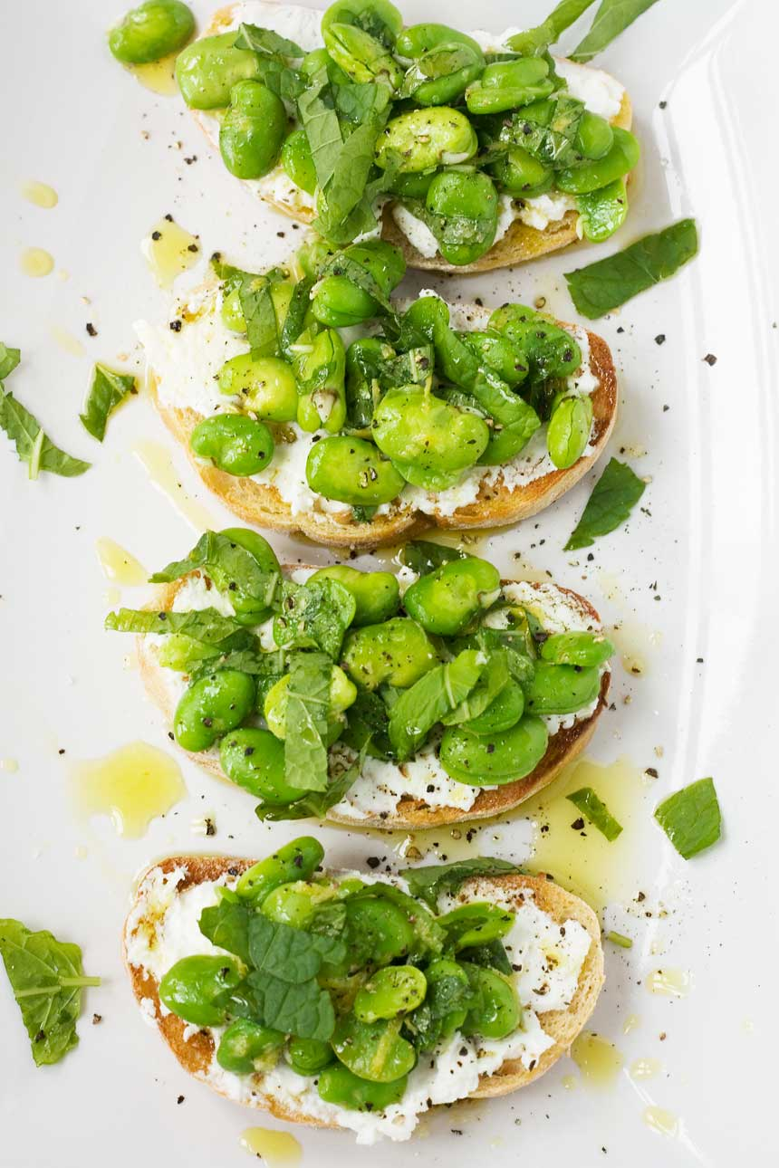 Simple crostini topped with ricotta and nutty fava beans flavoured ...