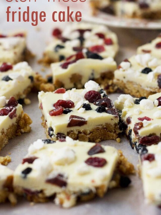 A close up of pieces of Eton Mess fridge cake on baking paper