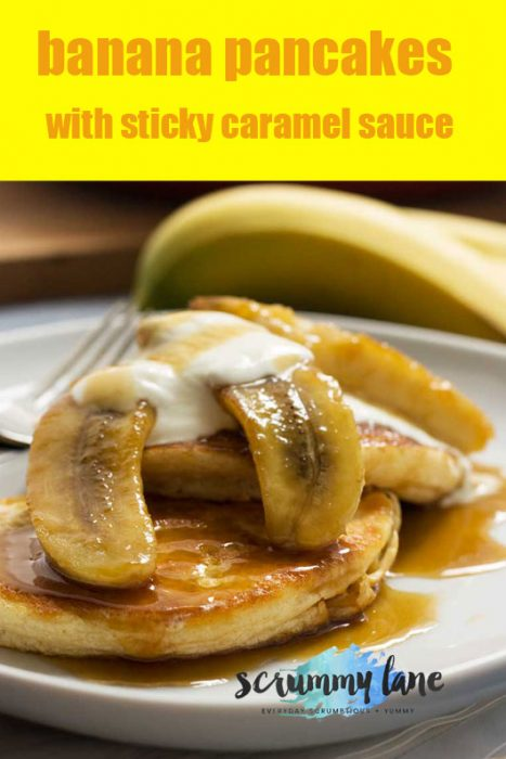 A plate of fluffy pancakes with bananas and caramel sauce on top