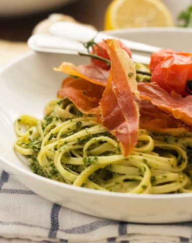 Kale and walnut pesto linguine with roasted tomatoes and crispy prosciutto