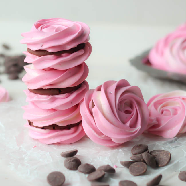 Raspberry meringue sandwiches with whipped dark chocolate ganache from Baking a Moment