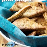 A dish of wholemeal Greek pita chips with a blue background