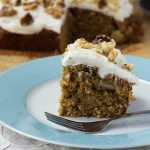 A piece of Hummingbird cake on a light blue plate with a fork