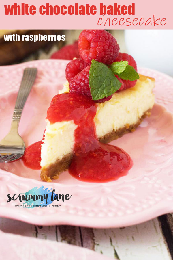 a slice of white chocolate baked cheesecake with raspberry coulis