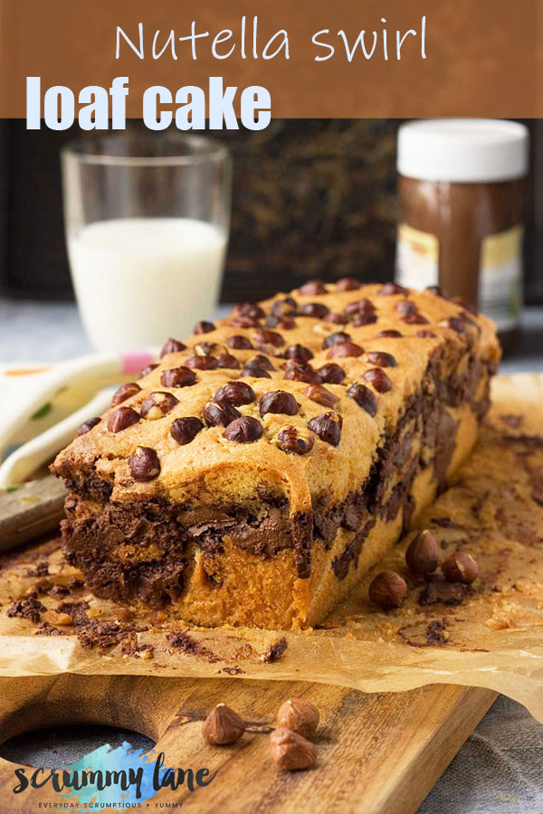 A Nutella swirl loaf cake with hazelnuts on the top