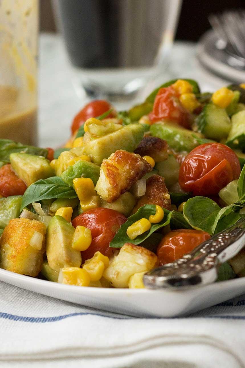 Tomato, corn, avocado and basil salad (with crispy halloumi cheese!)