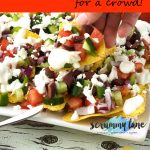A plate of Greek nachos for Pinterest