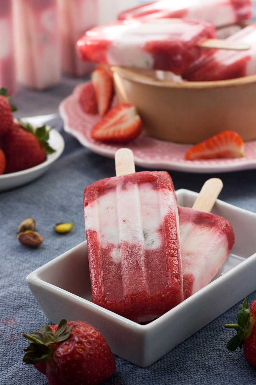 Strawberry pistachio yoghurt popsicles