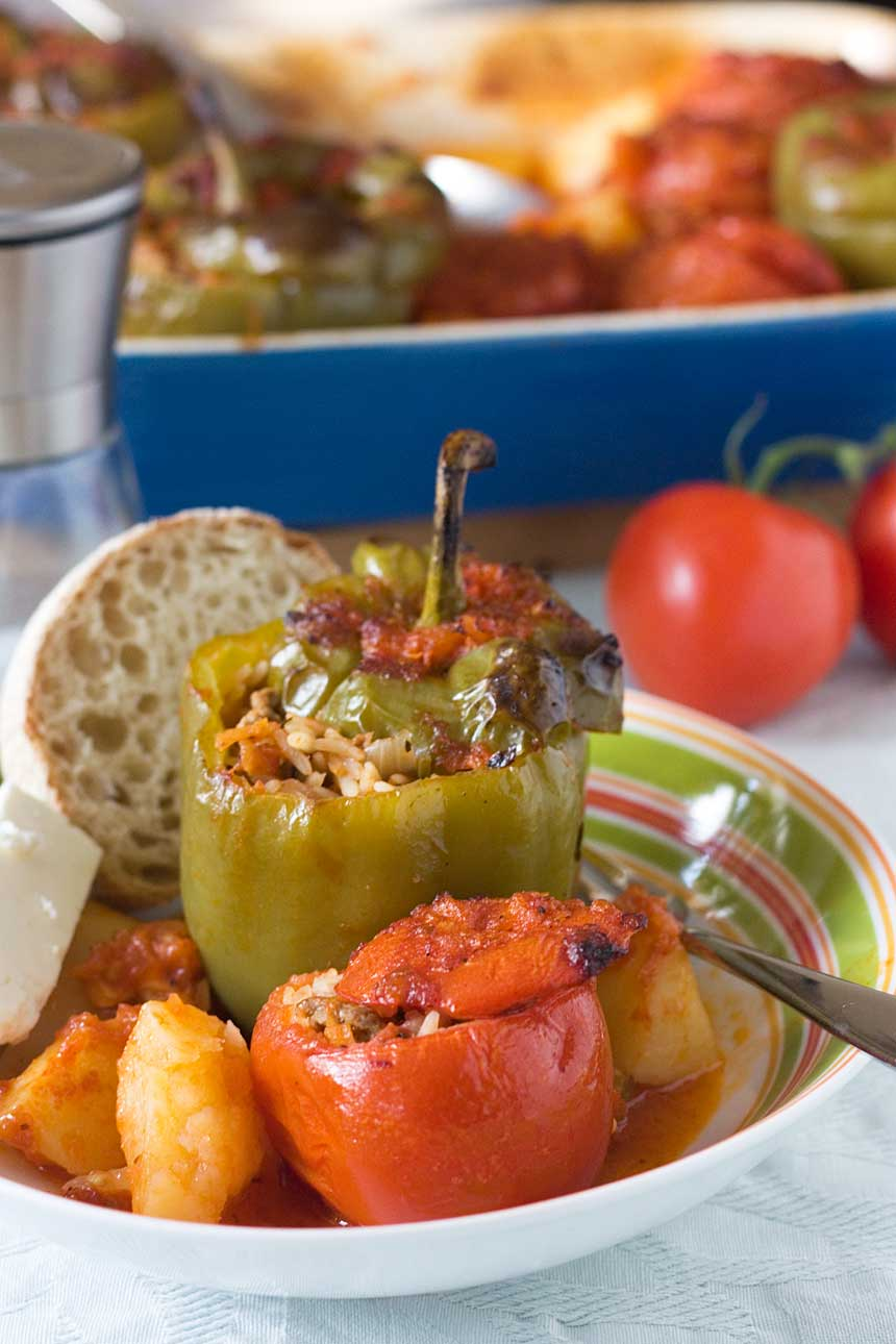Greek stuffed tomatoes and peppers - Greek 'peasant' food that's remained popular for a reason!