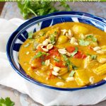 A blue dish of Thai Massaman chicken curry with sweet potato and peanuts