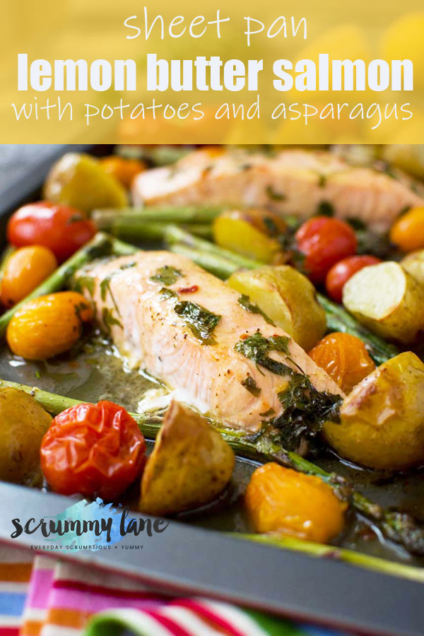 Salmon in lemon butter sauce with potatoes and asparagus on a sheet pan