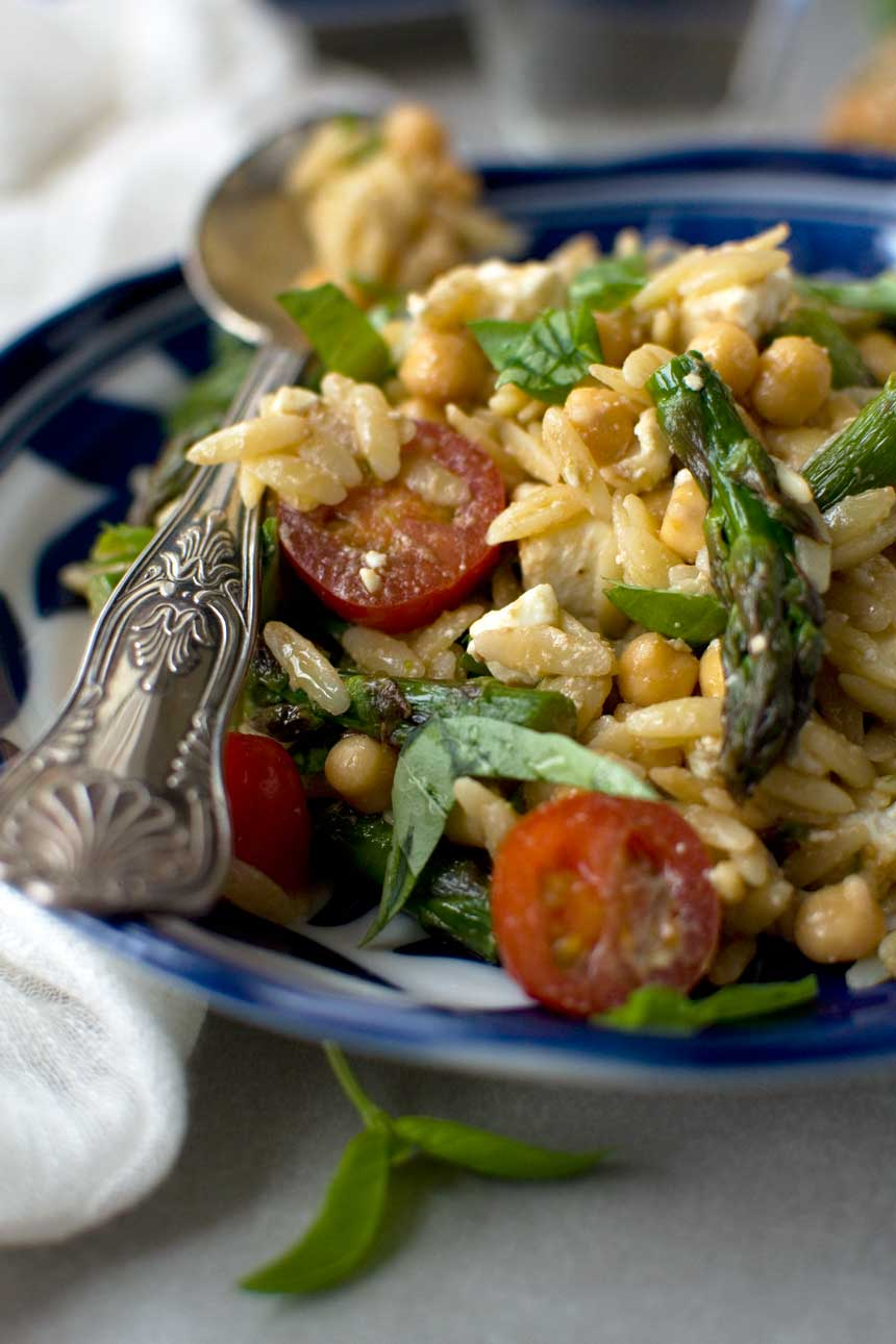 Asparagus, tomato and feta orzo salad - goes perfectly with chicken, fish, or steak!