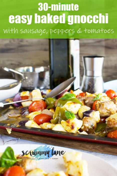 A baking tray of baked gnocchi with sausage, peppers and tomatoes for Pinterest