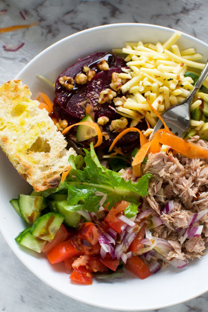 Close up of an easy tuna salad in a white bowl from above