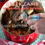Someone shredding slow cooked Greek lamb with lemon garlic potatoes - image for Pinterest