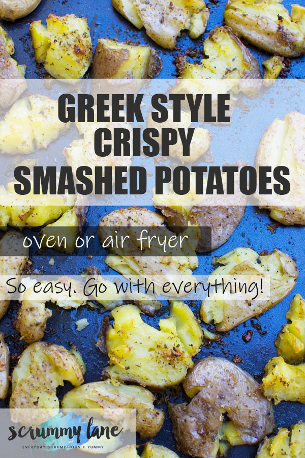 Pinterest image of Greek style crispy smashed potatoes on a baking tray