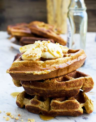 A stack of healthy banana waffles with more in the background