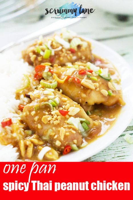 A dish of baked chicken thighs covered in a spicy Thai peanut sauce