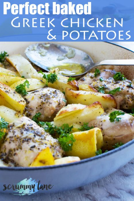 Greek baked chicken and potatoes in a blue cast iron pan