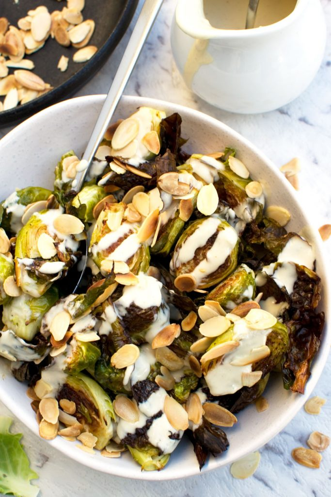 Crispy brussels sprouts with tahini sauce and almonds - overhead