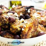 A bowl of Greek marinated chicken wings with feta and olives