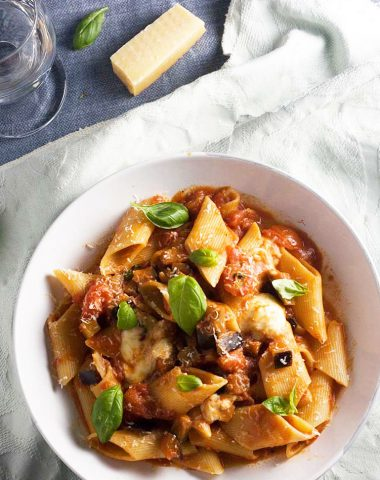 A bowl of pasta alla norma or tomato and eggplant pasta from above