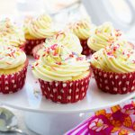 A cake stand full of healthier vanilla cupcakes with 2-ingredient frosting