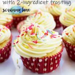 Healthier vanilla cupcakes with a 2-ingredient frosting on a cake stand