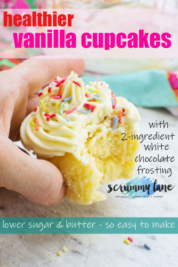 A person holding a healthier vanilla cupcake with a bite out of it