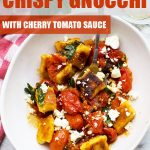 A bowl of crispy pan fried gnocchi with cherry tomato sauce