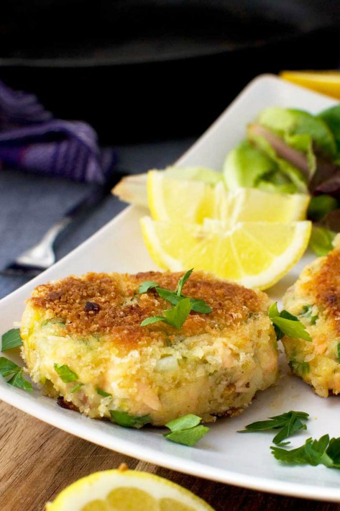 A plate of crispy salmon fish cakes with lemon