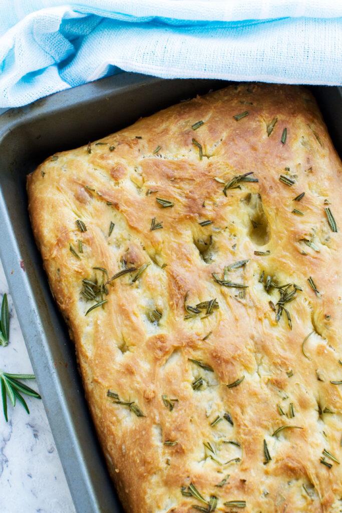 A pan of freshly baked Italian focaccia bread