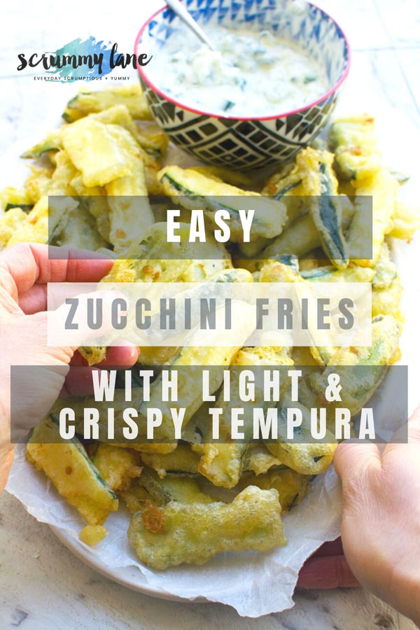 Pinterest image of a plate of someone eating zucchini fries with crispy tempura batter