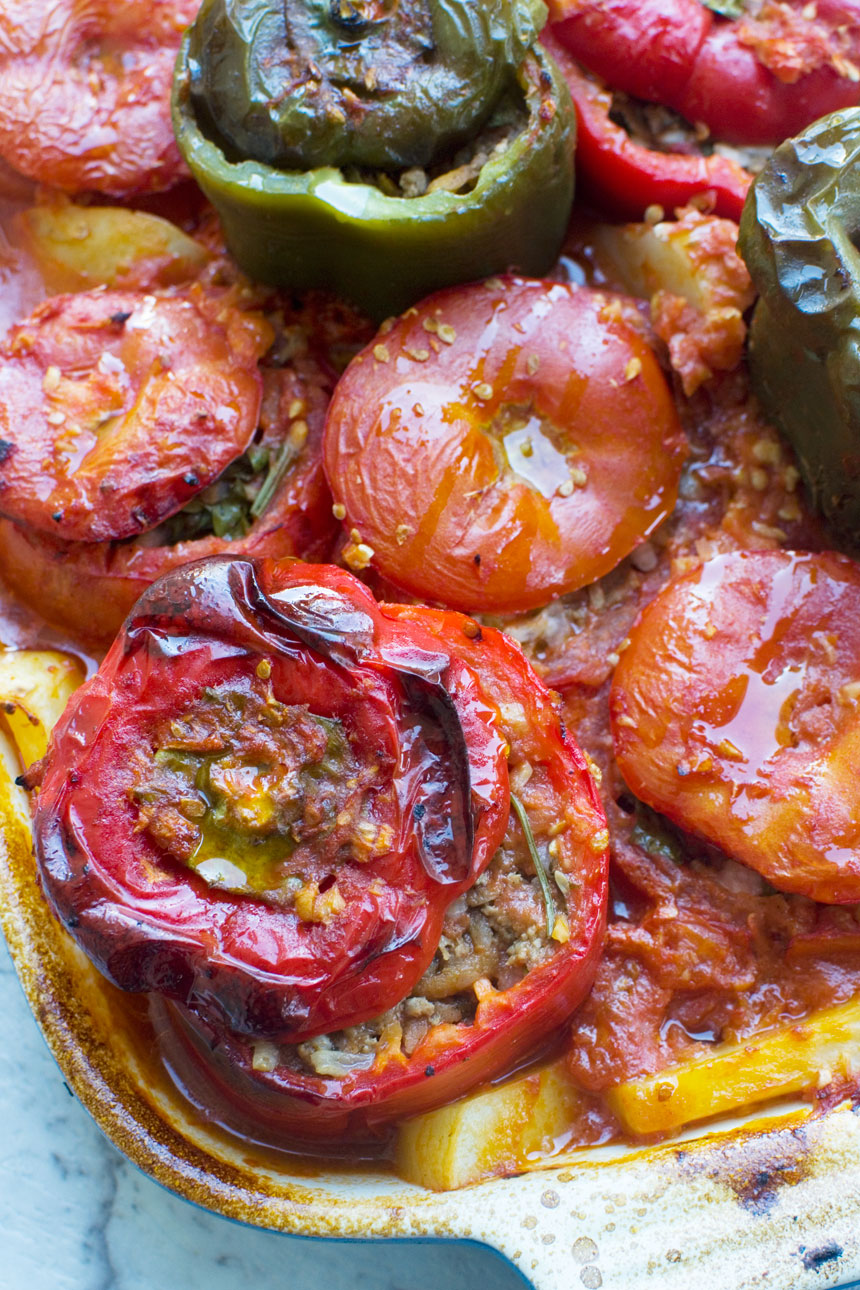 A close up of a pan of cooked gemista or Greek stuffed peppers and tomatoes