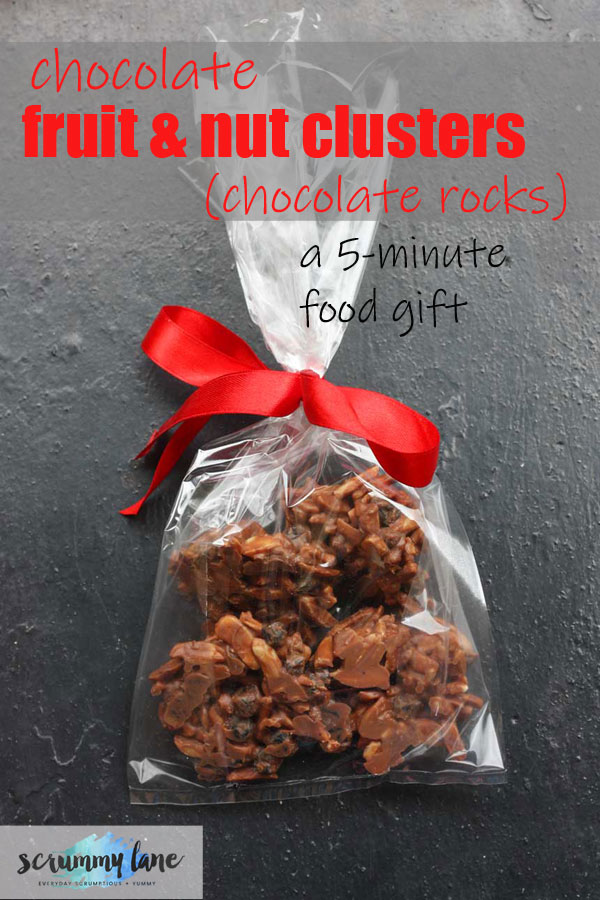 Pinterest image of a gift bag full of chocolate fruit and nut clusters (chocolate rocks)